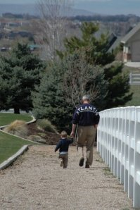 My Uncle Lew walking with his grandson.